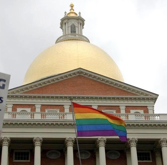 The Massachusets Statehouse with a rainbow flag flying in front of it on June 14, 2007, the date the state legislature voted to uphold the legality of same-sex marriage.
