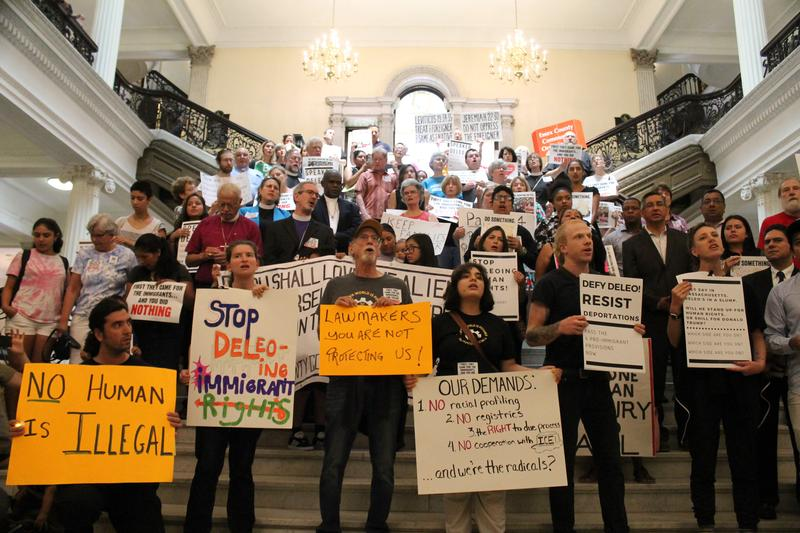 Demontrators at the Massachusetts State House during an immigration enforcement protest on July 24, 2018.