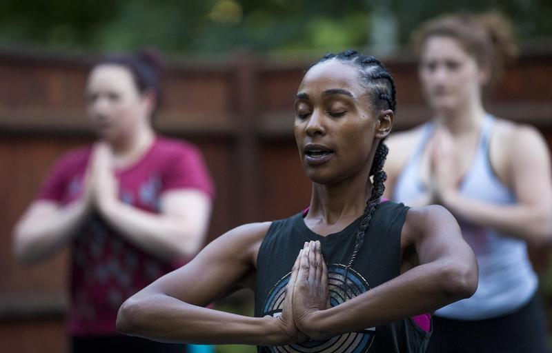 Kijana Rose directs her Beginners Ganja Yoga Flow students. (Jesse Costa/WBUR) Kijana Rose directs her Beginners Ganja Yoga Flow students.