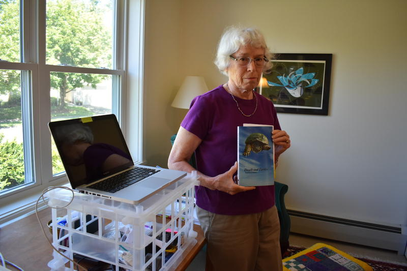 South Hadley, Massachusetts author Enid Sichel holds her book,