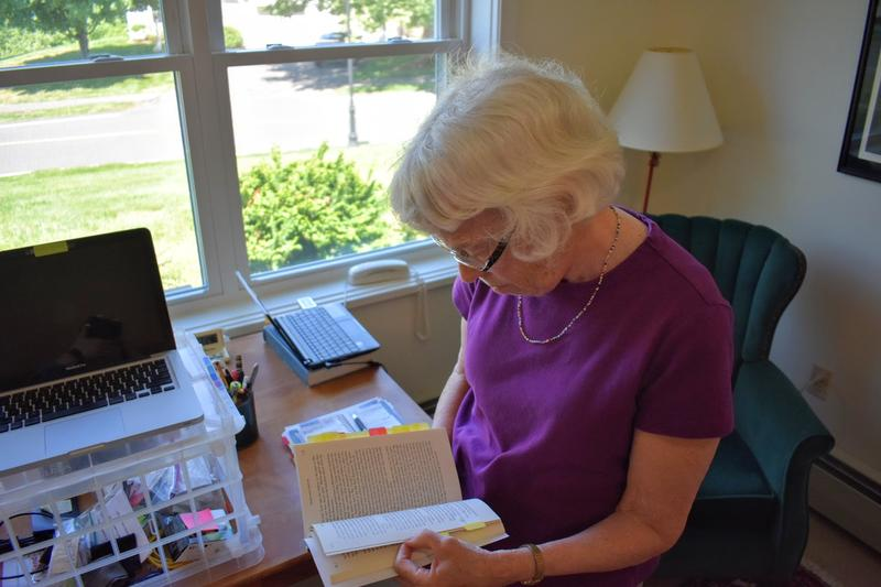 South Hadley, Massachusetts, author Enid Sichel stands at her homemade standing desk, where she wrote her latest Lord David Cholmondeley mystery.