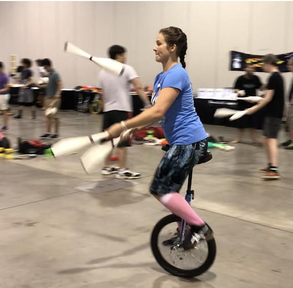 Erin Riley juggles on a unicycle on July 17, 2018 at the MassMutual Center.