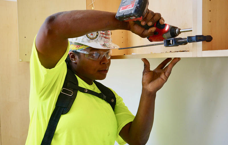 Carpenter Tyeka Robinson said she wishes she would have had more encouragement from women in the building trades when she was first starting out.