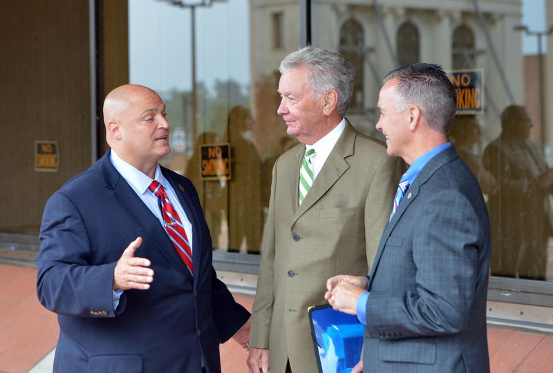 Registrar of Deeds Donald Ashe talked with Sheriff Nick Cocchi and state Representative Brian Ashe at the Hampden County Hall of Justice on September 6, 2016.