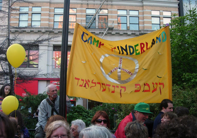 A Camp Kinderland banner supports the labor movement at a May Day gathering in 2012.