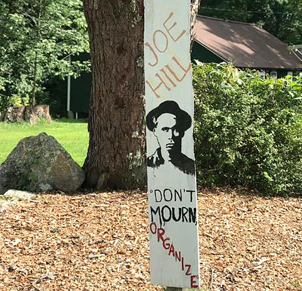 A sign outside the Joe Hill cabin at Camp Kinderland in Tolland, Massachusetts.