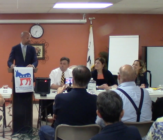 Massachusetts State Senator Adam Hinds moderates a debate in Becket, Massachusetts, for Democratic candidates for Berkshire County District Attorney on August 14, 2018. From left, the candidates are Paul Caccaviello, Judith Knight and Andrea Harrington.