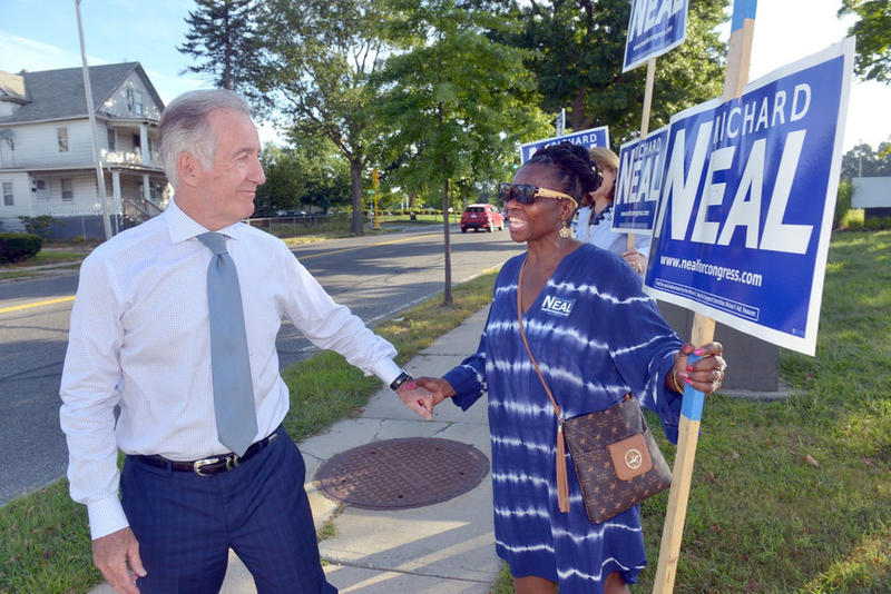 Congressman Richard Neal greets supporter Diana Kibodya outside the Springfield Boys and Girls Club as he arrives to vote on primary election day.