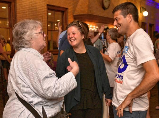 Jo Comerford, center, with Clare Higgins and Michael Aleo during an election night party.