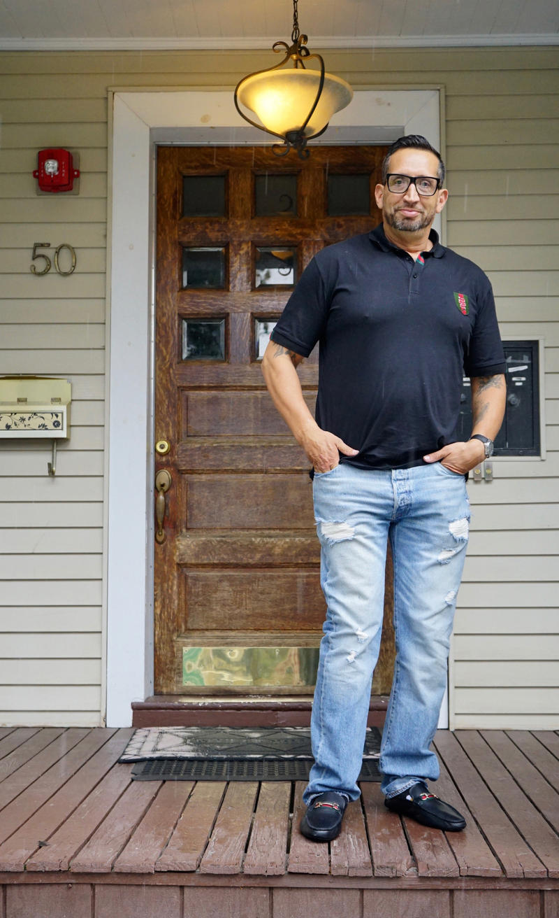 Mike Earielo stands in front of an apartment in Worcester, Massachusetts, that he rents from an organization called Dismas House.