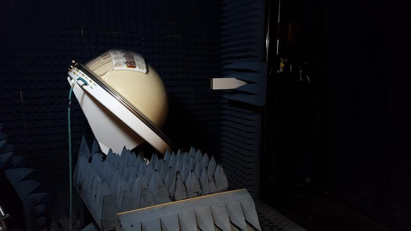 Chris Merola tests the multi-beam prototype in a dark, anechoic chamber at UMass Amherst.