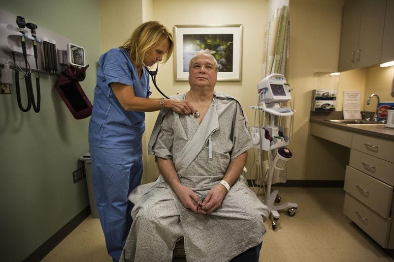 Ron Dombrowski is examined by nurse practitioner Pamela Park at the Wiener Center for Preoperative Evaluation at Brigham and Women's Faulkner Hospital.