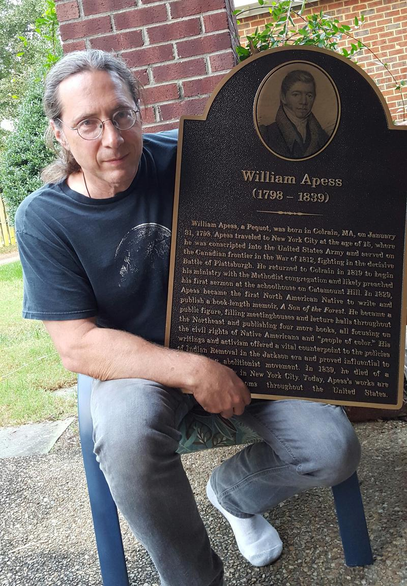 Drew Lopenzina poses with a historical marker honoring William Apess.