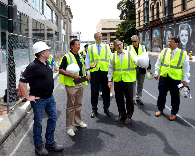 MGM's Mike Mathis (second from left) gives a tour of the casino site to officials including Governor Charlie Baker and Springfield Mayor Domenic Sarno.