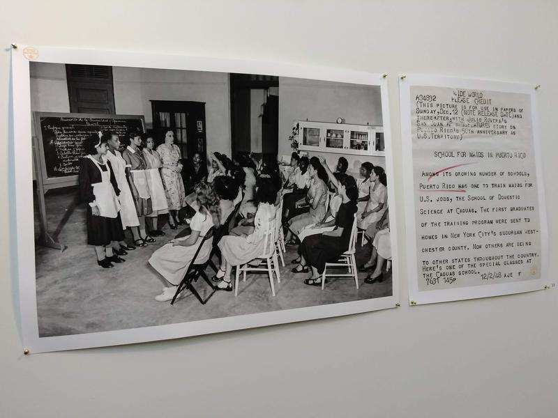 Part of Pablo Delano's exhibit is a 1948 newspaper clipping of young Puerto Rican women wearing maid uniforms.
