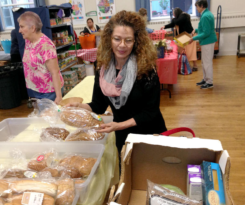 Oliva Llano visits the food pantry.