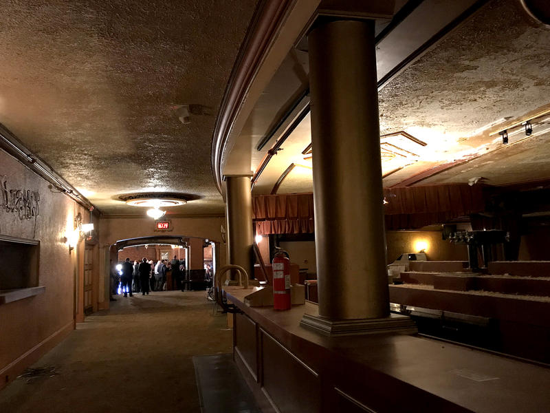 The Paramount Theater lobby hosted a press conference announcing state funding to help a planned rehabilitation.