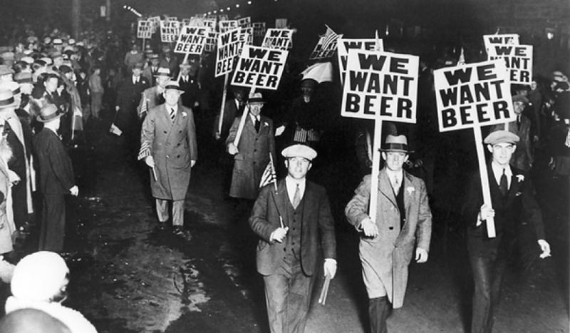 Labor union members in Newark, New Jersey march against Prohibition, carrying signs that read,
