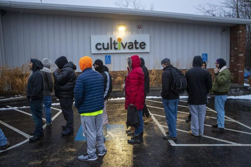 A line forms outside of Cultivate in Leicester, Massachusetts, one of two stores to legally sell marijuana recreationally in the state.