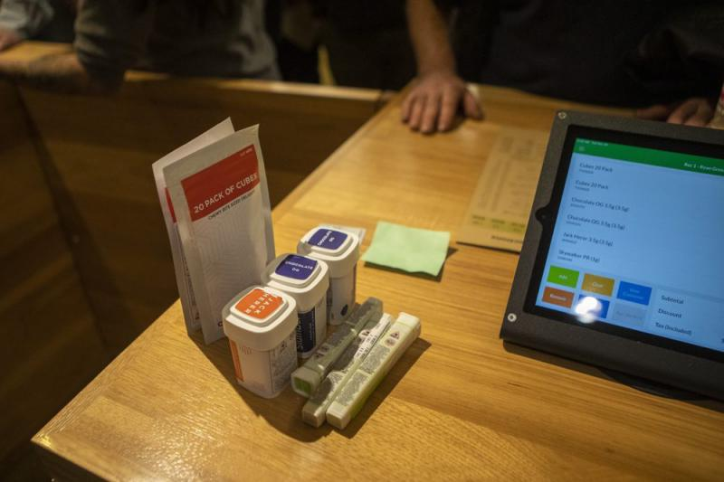 Marijuana products sit on a counter at Cultivate in Leicester, Massachusetts, as they're rung up for purchase.