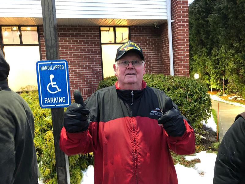 Roger Crocker, who drove from Connecticut, waits in line outside NETA on Tuesday.