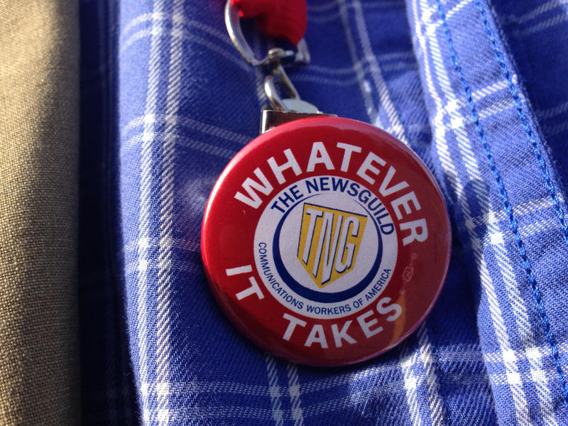 Daily Hampshire Gazette editor Dave Eisenstadter wears a pin advocating for a labor union.