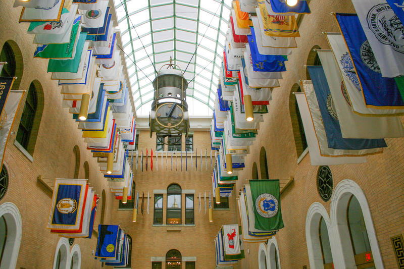 The Great Hall in the Massachusetts Statehouse, featuring town flags.