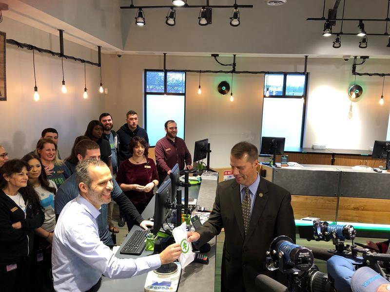Northampton Mayor David Narkewicz makes the first purchase at NETA from co-owner Arnon Vered on November, 20, 2018.