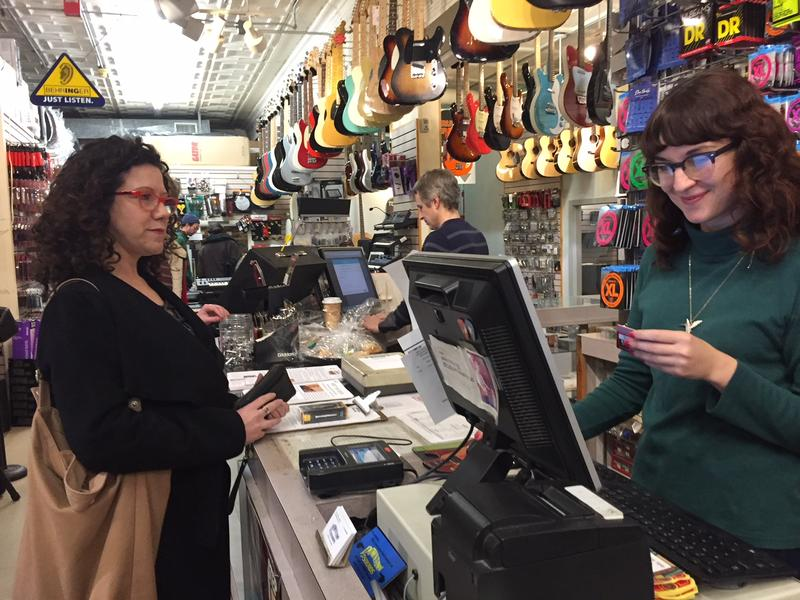 A customer buying clarinet reeds at Downtown Sounds.