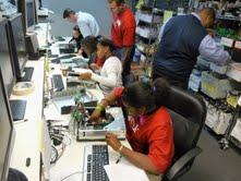 Middle school students in North Carolina help refurbish computers at Lenovo's Kramden Institute in Durham, N.C.