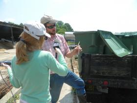 Pete Gallins, of Gallins Family Farm, explains to WFDD's Keri Brown the screening process he uses when making organic compost from food waste.