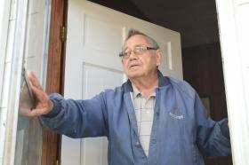 James Mabe, who has lived in the Hanestown Community for most of his life, stands in the doorway to his home on Ricks Drive in Winston-Salem.