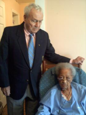 Arnold Palmer talks with Meals on Wheels client Juanita McBride at her home in Winston-Salem. Palmer delivered lunch to McBride on Friday. The delivery marks the 5-millionth meal served in Forsyth County.