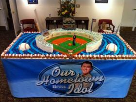 Bakers from North Carolina-based Lowes Foods made a cake display for Scotty McCreery during his hometown visit for the show American Idol in 2011. Their creation included 750 cupcakes, and more than 100 pounds of icing.