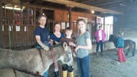 Leigh Summer and her family volunteer their time each week to take care of the animals at the Children's Home in Winston-Salem. They are also working with other supporters to develop programs that will help keep the animals at the farm.