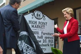 Gov. Pat McCrory (left) and Susan Kluttz, Secretary of the N.C. Department of Cultural Resources, unveil a furniture market historical marker in the 200 block of S. Main Street in High Point Monday, April 28.