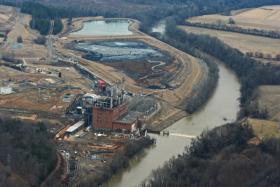 "In the foreground is the Duke Energy Dan River Steam Station. In the background are the two ash ponds. The ash/water mix from the forward ""primary"" pond drained into the Dan River on February 2, 2014."