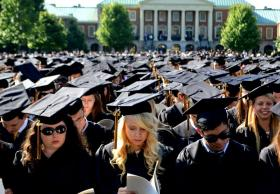 Wake Forest graduates await the beginning of the Commencement ceremony on Monday, May 19, 2014.