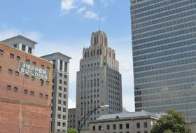 The Reynolds Building (center) has been part of the downtown Winston-Salem skyline since 1929. In this picture it is flanked to the left by the brick Pepper Building (circa 1928) the contemporary One West Fourth Street (2002) and to the right by Winston Tower (1966).