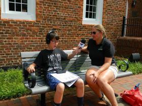 Radio Camper Damon Chrismon talks to Greensboro Science Center zookeeper Carmen Murray
