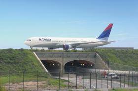 This is a photo of a taxiway-bridge project at the Hartsfield-Jackson Atlanta International Airport.  Residents might see a similar sight, if the Triad wins a big aviation tenant that could use the taxiway-bridge project. The plan is part of the Future I-73 now under way and will connect the Piedmont Triad International Airport to the land that it owns across Bryan Boulevard.