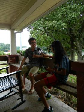 Radio Camper Siona Kshirsager talks with owner of the Garage, Tucker Tharpe