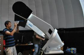 Crews install the new 24-inch telescope at Guilford Tech's Cline Observatory.