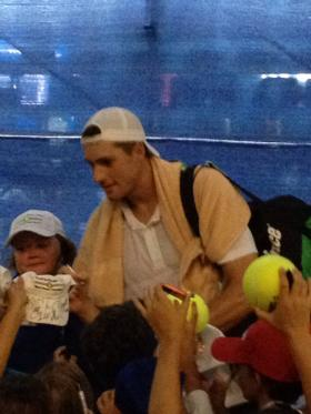 John Isner signs autographs at the Winston-Salem Open