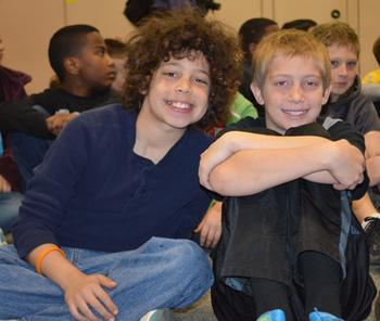 Meadowlark fifth grader Chris Boyd (blond on right) donated toys to help raise money for HERO.