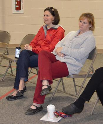 Martha Bethel (left in red jacket) teaches fifth grade at Meadowlark Elementary School. She's helped organize the fifth grade in-school yard sale since 2005.  She and other fifth grade teachers guide their students in learning about area charities.