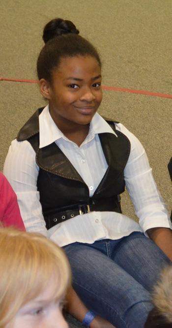 11-year-old Niya Grant now volunteers at HERO's barn and enjoys taking care of the horses.