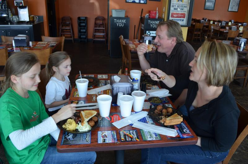 Members of the Berini Family enjoy their first lunch at Bib's Downtown in Winston-Salem. When they travel, they like to sample a city's best barbeque.