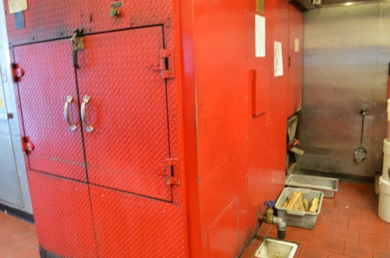 Bib's custom smoker cooks 1,000 pounds of meat at a time. It's fueled by hickory wood and runs almost 24/7.