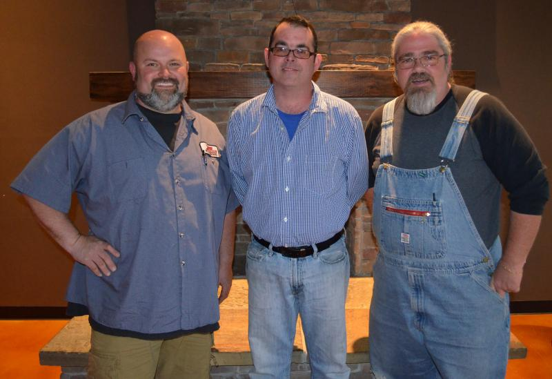 Ricky Seamon (left), Robert Moreau (center) and Mark Little (right) own Bib's Downtown in Winston-Salem.  Later this month, Seamon and Little will compete in the national reality TV show, BBQ Pitmasters.